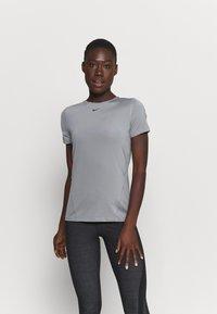 Nike Performance - ALL OVER - Camiseta básica - smoke grey/black - 0