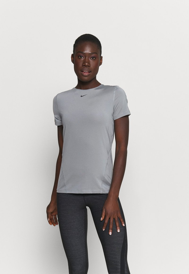Nike Performance - ALL OVER - Camiseta básica - smoke grey/black