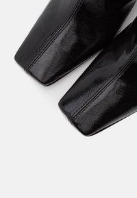 Topshop - VEGAN VIVA FLARED BOOT - Bottines à talons hauts - black - 5