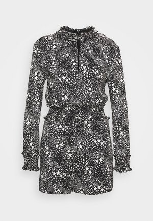 IKRELA - Jumpsuit - etoiles blanc/noir