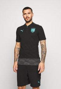 Puma - ÖSTERREICH ÖFB CASUAL - Polo shirt - black/blue turquoise - 0