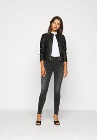 Vero Moda Petite - VMKHLOE  FAVO COATED JACKET PETITE - Faux leather jacket - black - 1