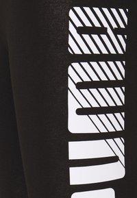 Puma - GRAPHIC LEGGINGS - Collants - black - 5