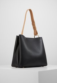 Inyati - JANE - Handbag - black/ latte