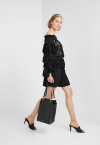 Coccinelle - MADELAINE - Handbag - noir - 1