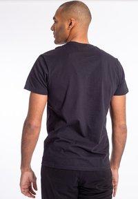 U.S. Polo Assn. - T-shirt - bas - tap shoe - 1