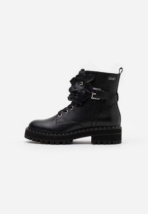 PINK  - Platform ankle boots - black