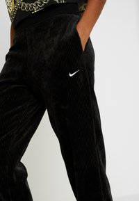 Nike Sportswear - Pantalon de survêtement - black/white - 6