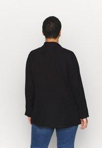 Dorothy Perkins Curve - SHORT WATERALL JACKET - Summer jacket - black - 2