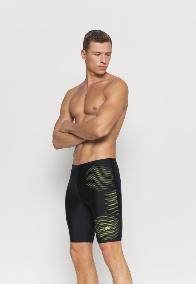TECH PLACEMENT JAMMER - Swimming trunks - black/fluo yellow