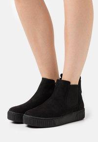 Marco Tozzi - Platform ankle boots - black - 0