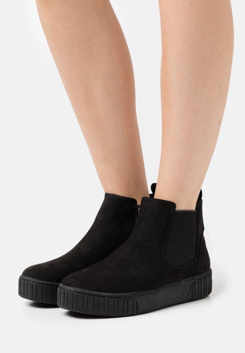 Marco Tozzi - Platform ankle boots - black