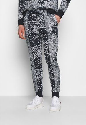 ARLO - Tracksuit bottoms - blue