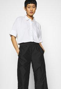 Hope - ACE TROUSER - Trousers - black taffeta - 3