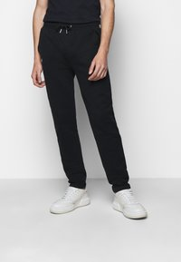 KARL LAGERFELD - PANTS - Tracksuit bottoms - black - 0