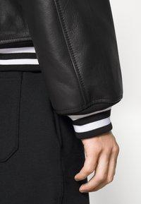 MOSCHINO - Leather jacket - black - 8