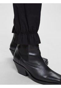 Selected Femme - Tracksuit bottoms - black - 4