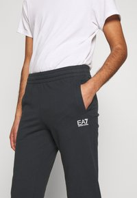 EA7 Emporio Armani - PANTALONI - Tracksuit bottoms - night blue - 4