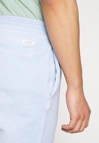 Calvin Klein - GARMENT FRONT LOGO - Teplákové kalhoty - blue - 3