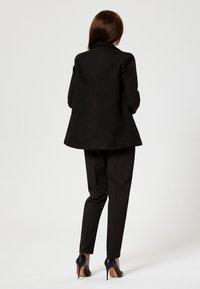 usha - Short coat - black - 2