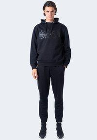 Armani Exchange - Pantaloni sportivi - black - 1