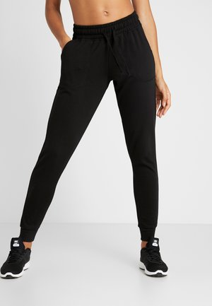GYM TRACKPANT - Verryttelyhousut - black