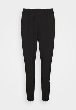 CONFIDENT PANT - Tracksuit bottoms - black