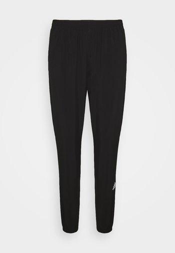 CONFIDENT PANT - Pantalones deportivos - black