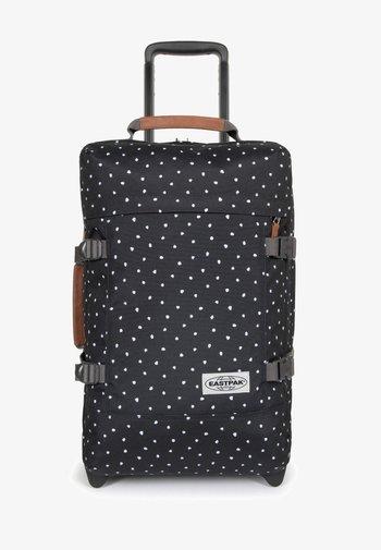 Wheeled suitcase - graded piece
