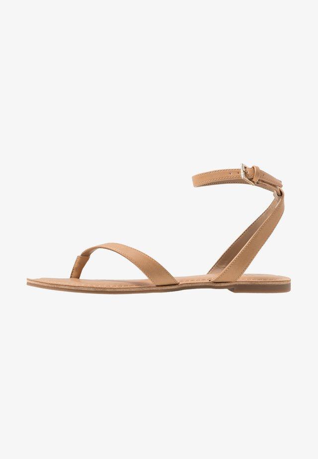 SIMKOTRA - T-bar sandals - beige