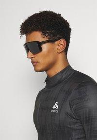Oakley - SUTRO LITE UNISEX - Sportbrille - black - 0
