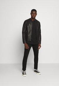 Jack & Jones - JORWARNER JACKET - Faux leather jacket - black - 1