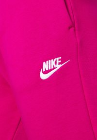 Nike Sportswear - Tracksuit bottoms - fireberry/white - 4