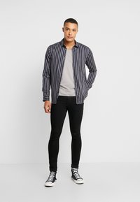 Jack & Jones - JJILIAM JJORIGINAL  - Slim fit jeans - black - 1