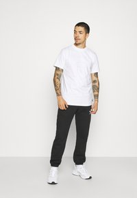 The North Face - STEEP TECH LIGHT - Camiseta estampada - white - 1
