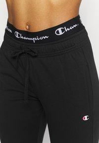 Champion - CUFF PANTS - Verryttelyhousut - black - 4
