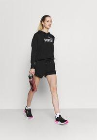 Puma - MODERN BASICS  - Pantalón corto de deporte - black - 1