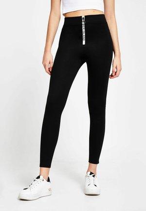 RI BRANDED ZIP FRONT - Leggings - Trousers - black