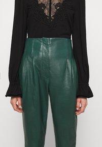 Alberta Ferretti - LEATHERPIECES TROUSERS - Trousers - green - 4