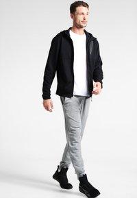 Puma - BONDED TECH  - Fleece jacket - black - 1