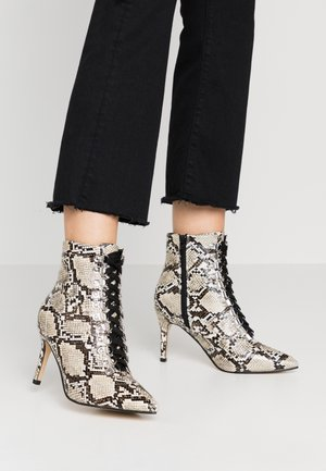 Lace-up ankle boots - natural