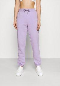 Monki - Pantaloni sportivi - lilac purple medium dusty - 0