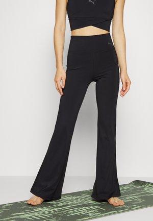 FLARED PANTS - Spodnie treningowe - black