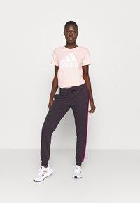 adidas Performance - PANT - Tracksuit bottoms - purple - 1