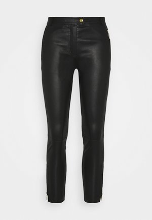 PANT ZIPPER POCKET AND ZIPPER AT BOTTOM - Leather trousers - black