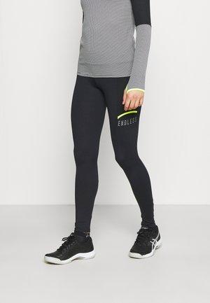 MALLAS FIT POCKET - Legging - black/yellow