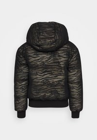 Calvin Klein Jeans - ZEBRA PUFFER - Light jacket - irish cream/black - 1