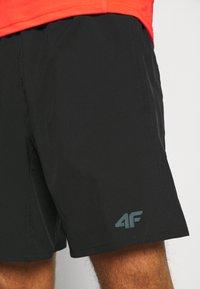 4F - Men's training shorts - Sports shorts - black - 3