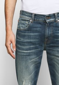 7 for all mankind - SLIMMY GUARD  - Jeans Tapered Fit - dark blue