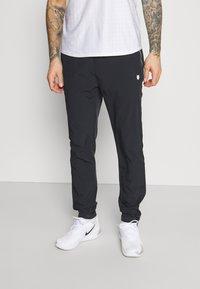 K-SWISS - HYPERCOURT TRACKSUIT PANT - Teplákové kalhoty - blue graphite - 0
